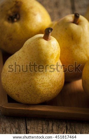 Fruit background. Fresh organic pears on old wood. Pear autumn harvest - stock photo