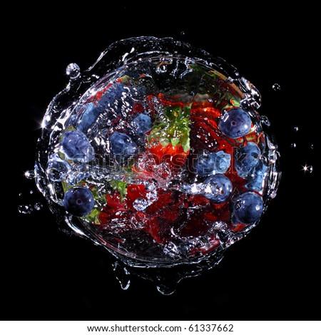Fruit ball - Fruit splashing into a glass - stock photo