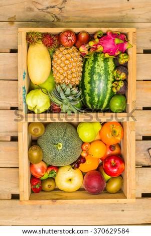 fruit basket on a wood background - stock photo