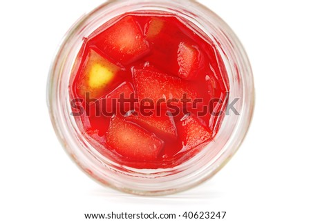 Fruit berry  jelly in the glass cans with apples and pears peaces isolated on the white.