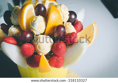 Fruit bouquet decoration on the dining table, fruit bouquet in focus