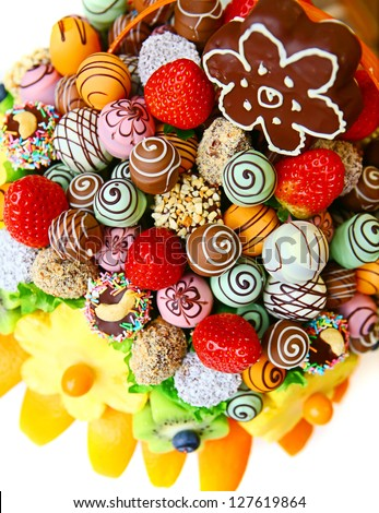 Fruit bouquet with strawberry, pineapple, kiwi and chocolate - stock photo