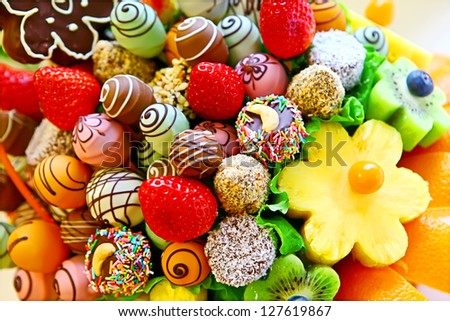 Fruit bouquet with strawberry, pineapple, kiwi and chocolate