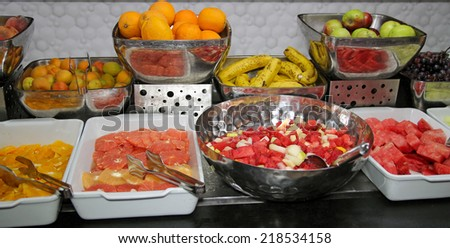 Fruit Buffet . Food Buffet in Restaurant. All inclusive. Breakfast buffet.  Self service restaurant. Mixed fruit platter with strawberries, mango, melon, grapes, apricots.  - stock photo