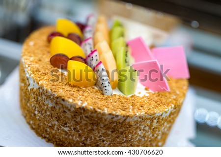 Fruit cake and all kinds of delicious fruit - stock photo