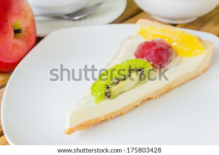 Fruit cake in white dish on the wood table