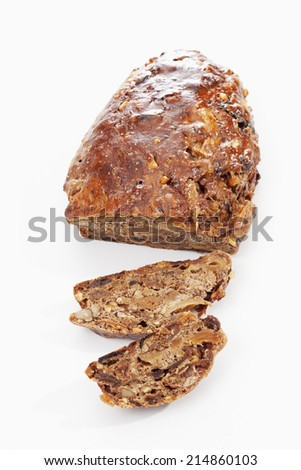 Fruit cake sliced on white background elevated view