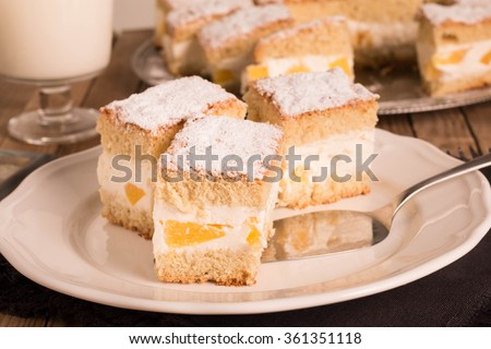 Fruit Cake with cheese cream and fruits. Selective focus.