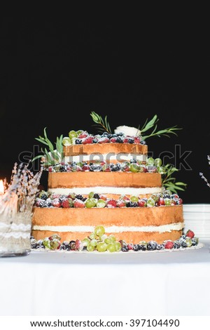 fruit cake with powdered sugar on table