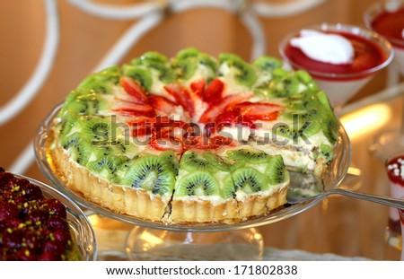 Fruit cake with strawberries and kiwi - stock photo