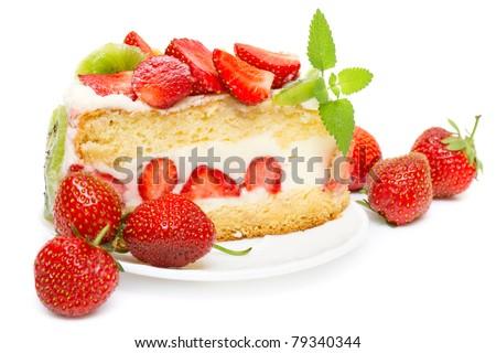 fruit cake with strawberries and kiwi fruit isolated on white - stock photo