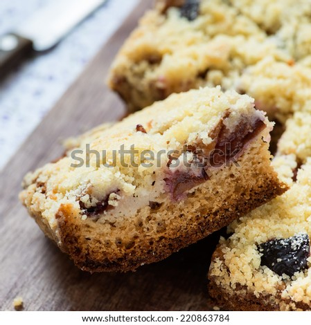 Fruit cake with streusel on wooden board, selective focus, closeup
