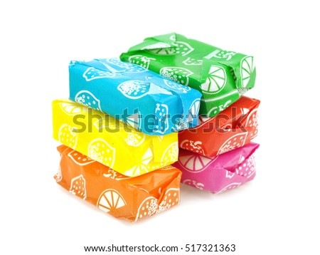 Fruit candies on a white background