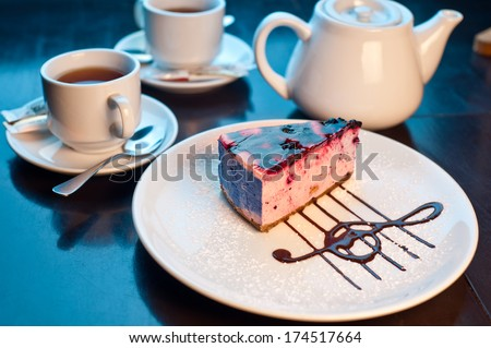 Fruit cheesecake with cups of tea - stock photo
