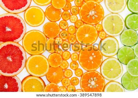 Fruit citrus background with grapefruit, orange, tangerine, lemon, lime and kumquat. Top view. - stock photo