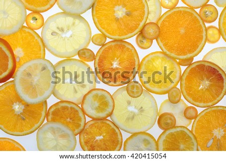 Fruit citrus background with orange, tangerine, lemon and kumquat - stock photo