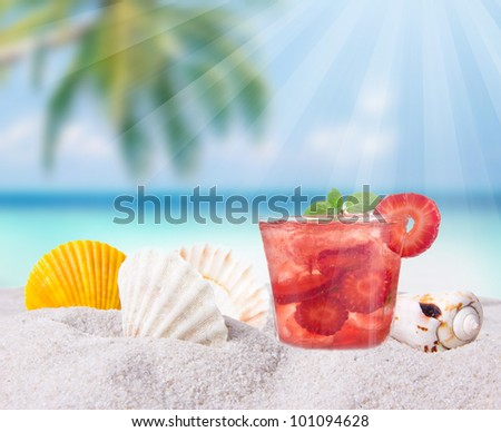 Fruit cocktail on a beach - stock photo