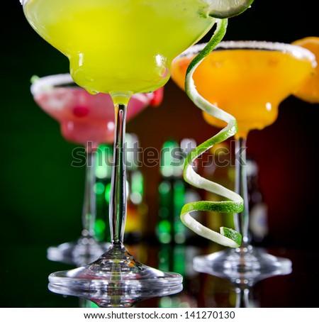 Fruit cocktails on black background - stock photo