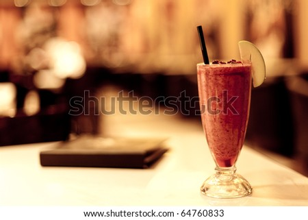 Fruit coctail and menu in night cafe