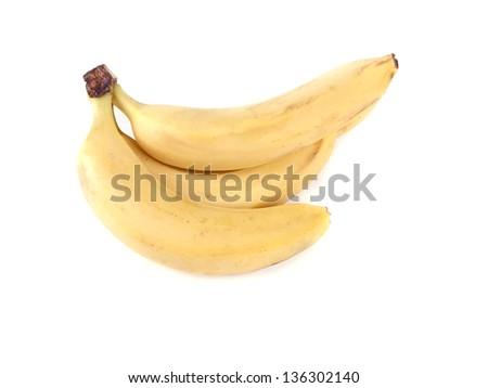Fruit composition of ripe bananas on white background - stock photo