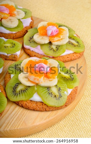 Fruit dessert with exotic fruits on a wooden background - stock photo