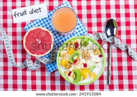 Fruit diet. Fruit with yogurt, a glass of fresh juice and half a grapefruit on the table. The concept of dieting, losing excess weight. - stock photo