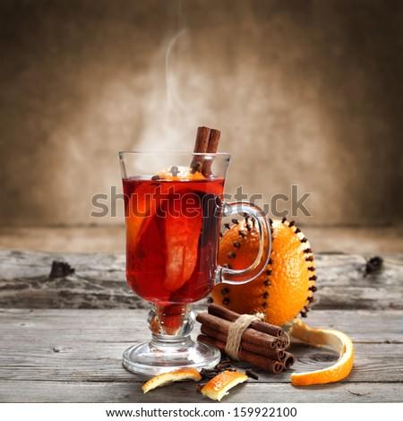 fruit drink and cinnamon  - stock photo