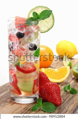 Fruit drink on wooden background - stock photo