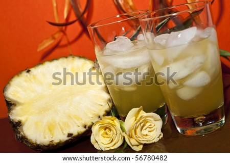 Fruit drink, pineapple, orange roses background