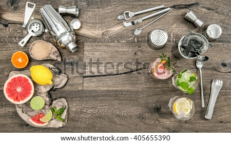 Fruit drinks with ice. Cocktail making bar tools, shaker, glasses. Flat lay. - stock photo