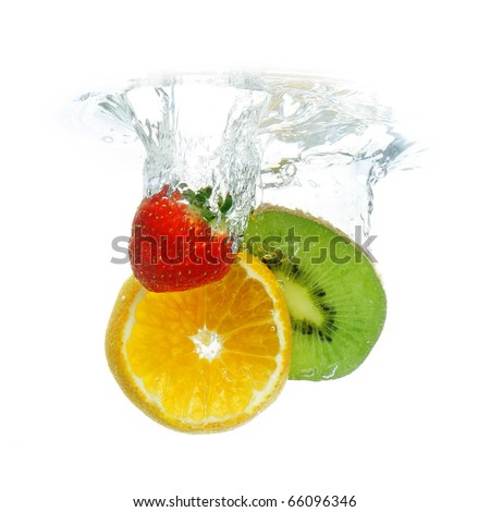 Fruit dropped in water, isolated on white - stock photo