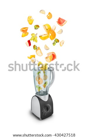 Fruit falling in a juicer on white background - stock photo