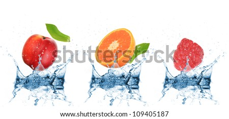 Fruit falling into water over white