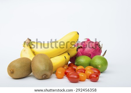 Fruit. Glasses of fruit and vegetable juice with fruits on a white background - stock photo
