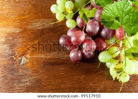 Fruit grape green and red on wooden background