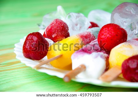 Fruit ice cream and fresh fruits, on a wooden abstract background