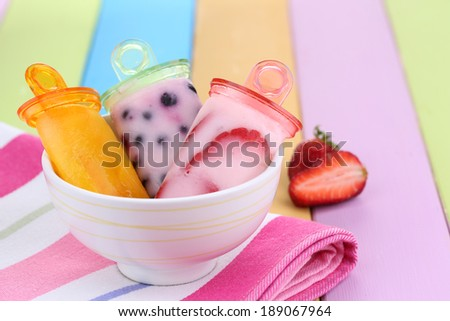 Fruit ice cream in bowl on wooden table close-up - stock photo