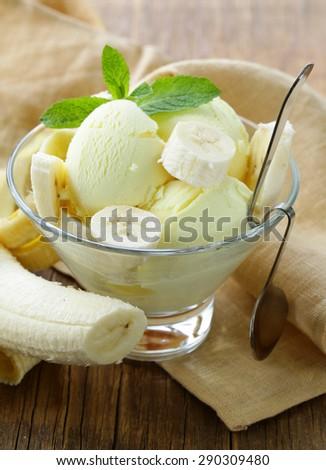 fruit ice cream with fresh banana and mint - stock photo