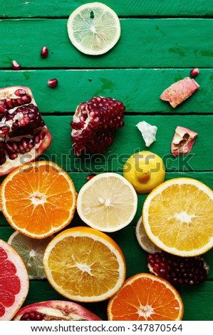 Fruit in a cut closeup, grapefruit, orange, lemon, tangerine, fruit background. rustic food. fruit. Fresh fruits.Mixed fruits background.Healthy eating, dieting, love fruits. - stock photo