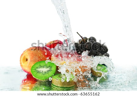 fruit in a spray of water isolated on a white background. - stock photo