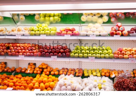 fruit in a supermarket shelve in blurry for background
