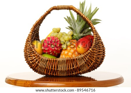 Fruit in a wicker basket on a white background - stock photo