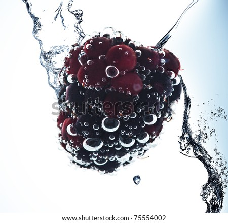 Fruit in pure water. Splash - stock photo