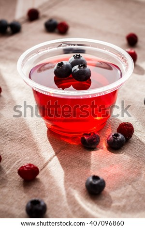 Fruit jelly sunlight. Dessert of jelly and berries.  - stock photo