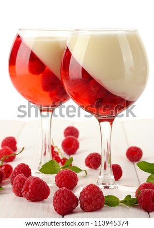 fruit jelly with berries in glasses on wooden table - stock photo