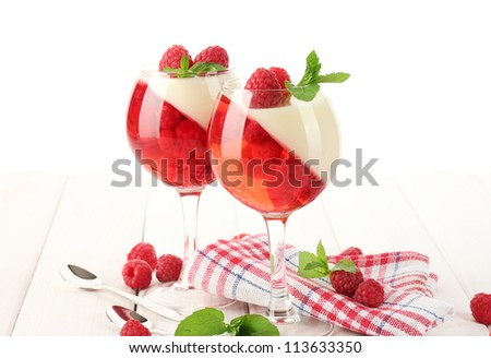 fruit jelly with raspberries in glasses on wooden table - stock photo