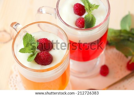 fruit jelly with yogurt, raspberries and mint