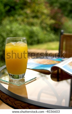 fruit juice and magazine shallow DOF focus on drink