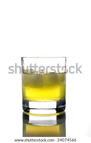 fruit juice drink with ice cube in crystal glass