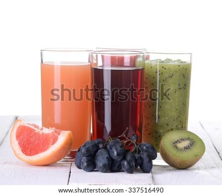Fruit juice ( grape , strawberries , kiwi , grapefruit  )  Isolated on white background. - stock photo